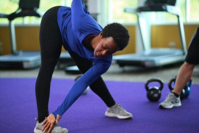 woman touching toes, stretching